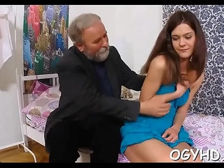 Young gal gives a blow to old penis