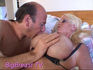 Busty babe squizing boobs hard