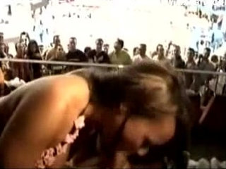 Spectators watch guy fuck girl at sports stadium